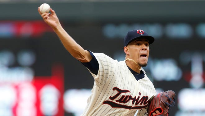 Minnesota Twins pitcher Jose Berrios throws against the Colorado Rockies during the third inning of the second game of a baseball doubleheader Thursday, May 18, 2017, in Minneapolis.