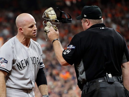 New York Yankees' Brett Gardner argues with home plate umpire Mark Carlson during the second inning in Game 6 of baseball's American League Championship Series against the Houston Astros Saturday, Oct. 19, 2019, in Houston. (AP Photo/Eric Gay)