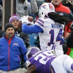 Buffalo Bills wide receiver Sammy Watkins catches a pass for a touchdown in front of Minnesota Vikings cornerback Xavier Rhodes with one second remaining in regulation on Sunday. The host Bills converted the extra point and won, 17-16.