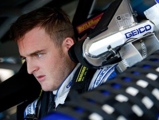 Ty Dillon sits in his car during practice for the Monster