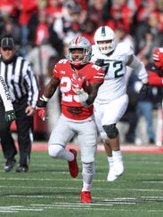 Mike Weber runs for an 82-yard TD vs. Michigan State in the second quarter Nov. 11.