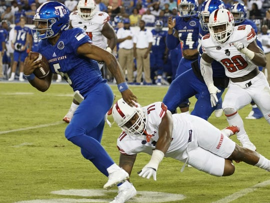 Treon Harris (5) and Michael Hughes split time at quarterback for Tennessee State Saturday night against Austin Peay at Nissan Stadium.
