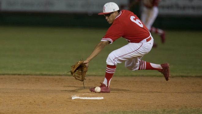 Robstown's second basemen Xavier Pena misses a ground ball at second during the fourth inning of their game in Sinton on Monday, April 10, 2017.