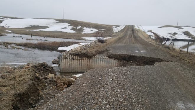 Flooding washed out part of Sam George Hill Road in Pondera County.