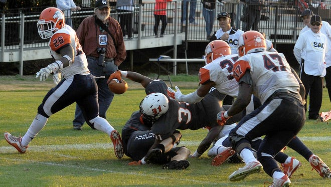 Tusculum's Jordan Shippy dives into the end zone on a game winning two-point conversion against Carson-Newman Saturday at Pioneer Field.