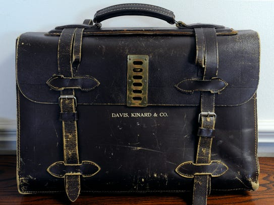 A weathered leather bag is on display in the Davis Kinard & Co.  office. The bags were commissioned when the accounting firm was formed in 1971.