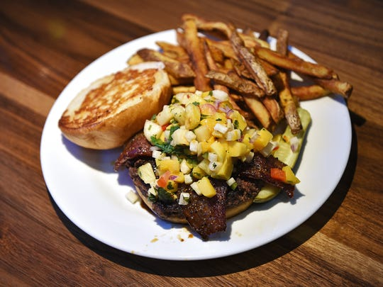 Hy-Vee Market Grille's Hy-Waiian burger at the restaurant inside the Hy-Vee location at 57th Street and Cliff Avenue in Sioux Falls.