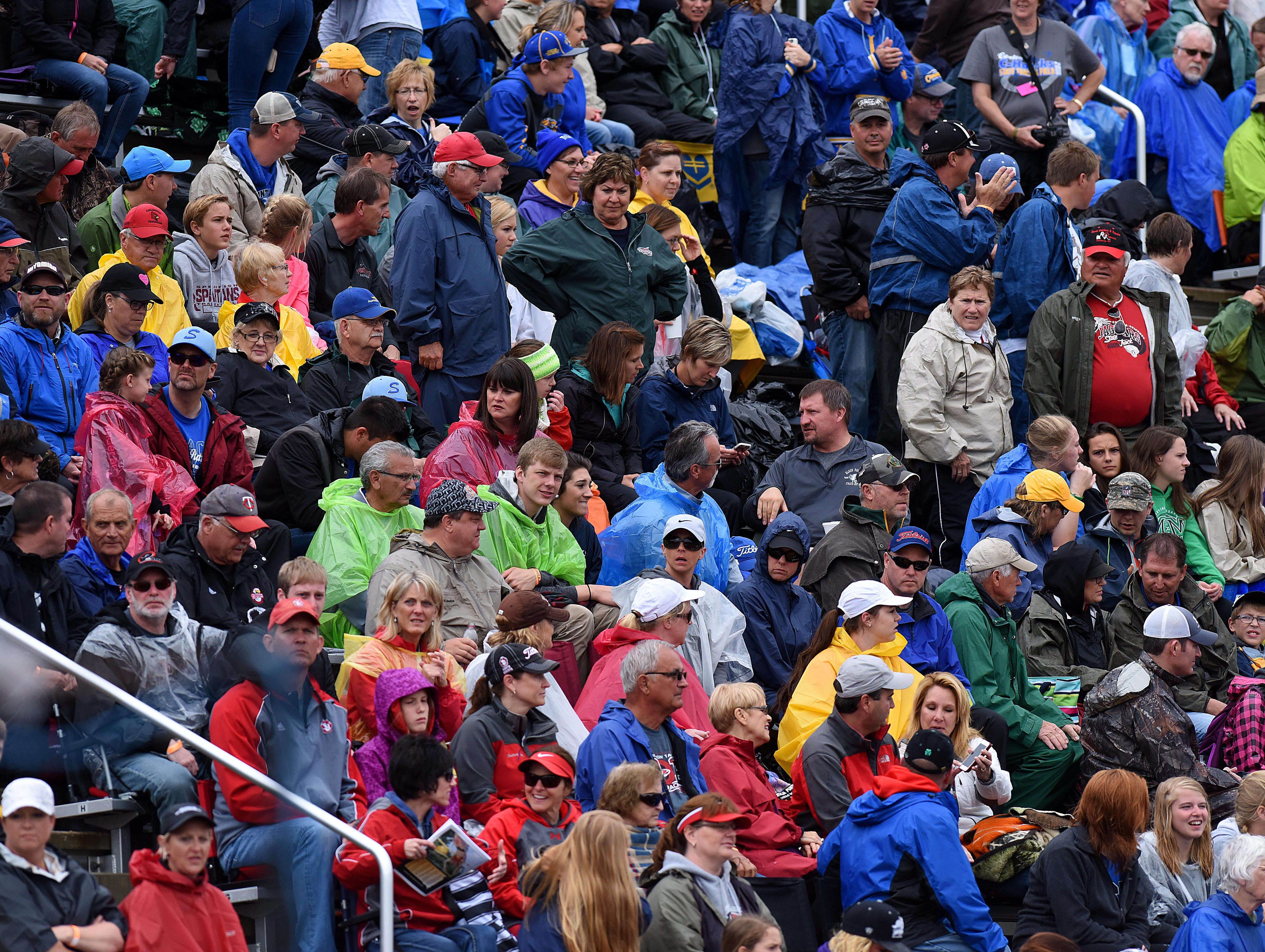 Spectators dress in rain gear while watching the 2016 SD State Track and Field Meet at Howard Wood Field on Saturday, May 28, 2016.