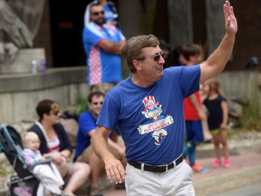 Sioux Falls mayor Mike Huether walks the 4th of July Family Parade in downtown Sioux Falls to Falls Park for a picnic during the annual holiday.