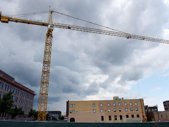 A giant yellow crane stands at 171 feet 5 inches, with