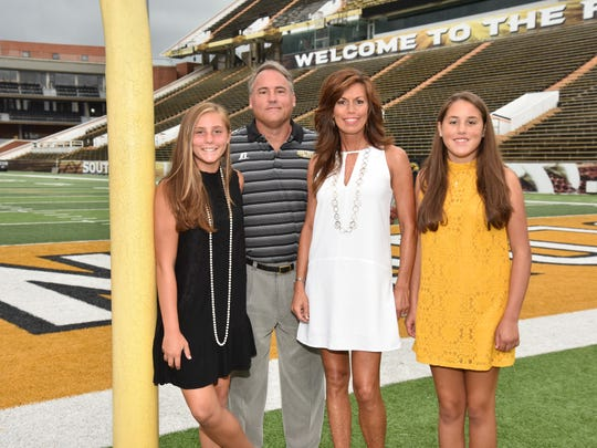 Jay and Michelle Hopson with their daughters Hyde, 15, and Hannah, 13.
