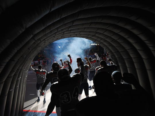 Sioux Falls Storm players take the field before a game at the Denny Sanford Premier Center in Sioux Falls.