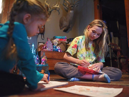 Faith Graham, 3, and her sister Makenzee, 12, color