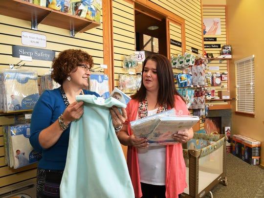 Safety Store educator Michelle Hoel, left, shows parent