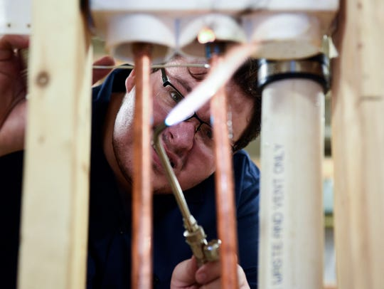 Patrick Rose, 21, a student in the plumbing program