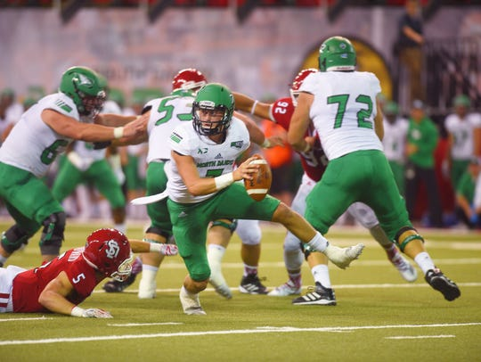 UND's Keaton Studsrud attempts to break past USD defense