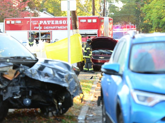 Firefighters at the scene of a crash investigation at Totowa Avenue in Paterson on Wednesday, Oct. 25, 2017.