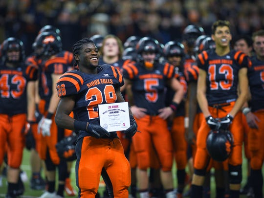 """Washington's Tupak Kpeayeh is given the """"Joe Robbie"""" award after the game against Roosevelt Saturday, Nov. 11, at the DakotaDome in Vermillion."""