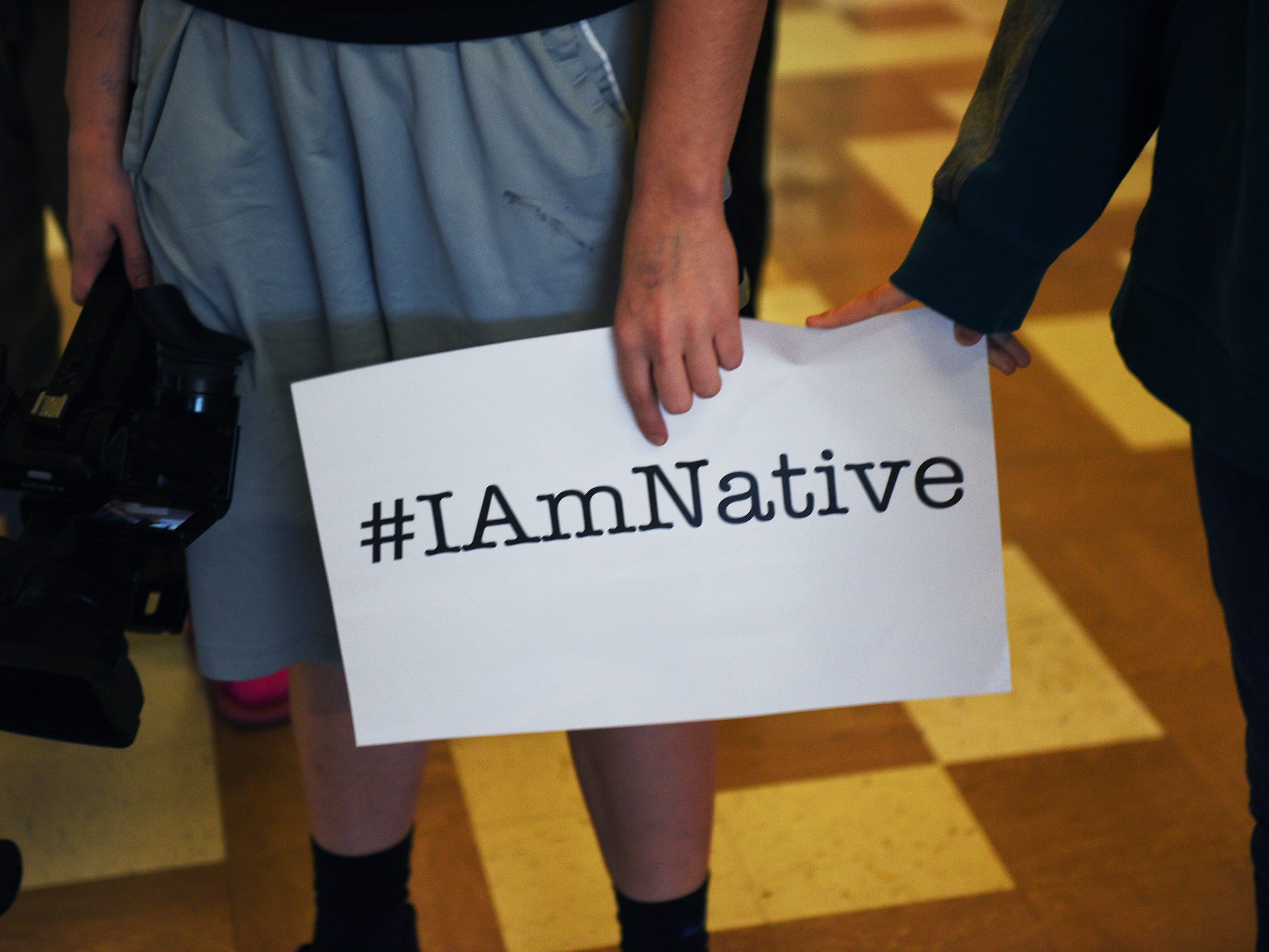 "Students in a multimedia class visit with students for a project they are working on titled ""#IAmNative"" at Todd County High School Wednesday, Nov. 15, in Todd County, South Dakota."