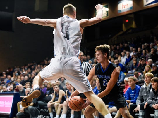 Sioux Valley guard Ryan Schuster (5) jumps in the air