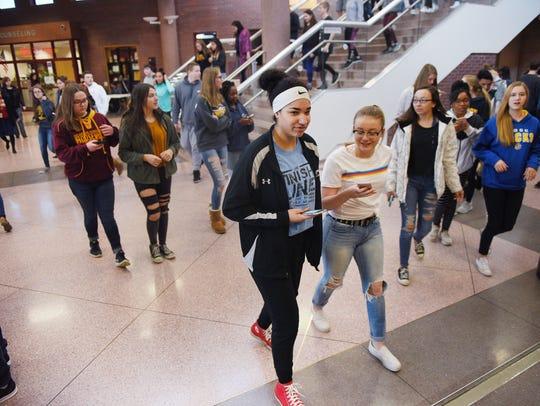 Roosevelt High School students Jadyn Burkett, center
