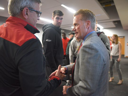 USD men's basketball coach Todd Lee shakes hands with attendees after the press conference announcing his new coaching position Friday, April 6, in Vermillion.