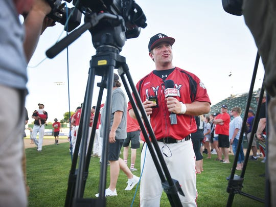 Brandon Valley coach Jeremy VanHeel gives interviews after the win against Pierre in the Class A state high school baseball championship Saturday, May 26, 2018 at Sioux Falls Stadium.