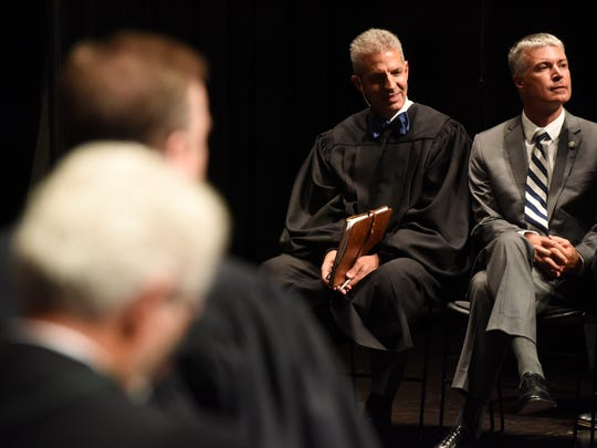 Mark E. Salter waits to be sworn in as the 51st Justice