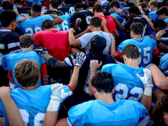 USJ and South Side players join together to kneel and