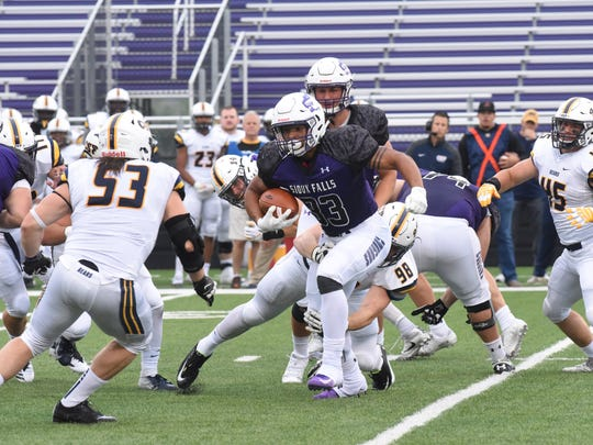 University of Sioux Falls Gabriel Watson (33) runs