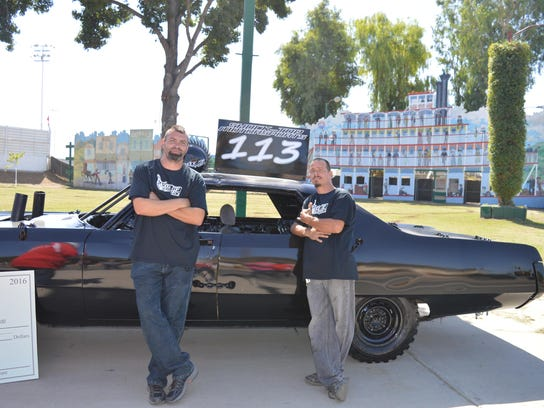 Eric Rossiter and his crewmate show off the vehicle