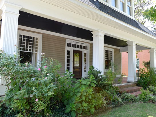 The Porterfields were able to refinish the porch while keeping the home's or.jpg
