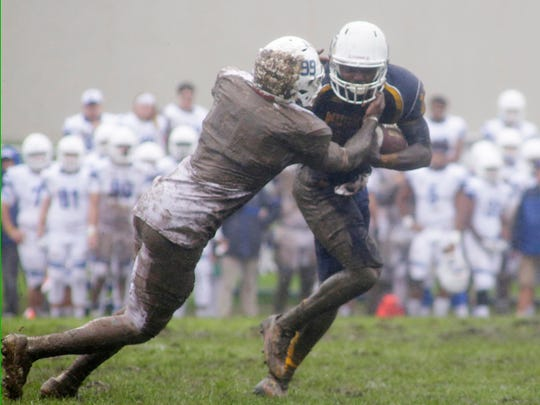 Lakeland University's Kezlow Smith (10) carries the ball by Concordia University's DeShawn Pullen (99) Saturday October 1, 2016 at Lakeland near Howards Grove.