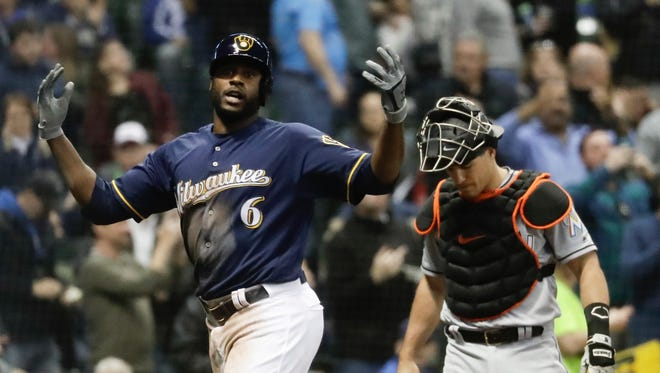 The Brewers' Lorenzo Cain celebrates his home run in the fifth inning Thursday night.