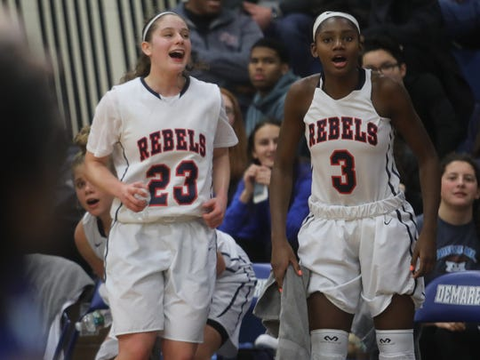 Michelle Sidor, left, and Jaida Patrick of Saddle River Day cheer on their teammates toward the end of the Bergen County Tournament game against Holy Angles. Saddle River Dell won and Sidor scored her 2,000th career point on Jan. 27, 2018.