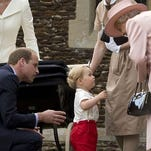 What's that, Gan-Gan? Prince George, flanked by daddy Prince William, has discussion with his great-grandmother, Queen Elizabeth II (he calls her 'Gan-Gan') at the christening of his baby sister Princess Charlotte in July 2015, at the queen's Sandringham estate in Norfolk.
