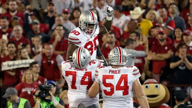Ohio State Buckeyes wide receiver Noah Brown (80) celebrates with offensive lineman Jamarco Jones (74) and offensive lineman Billy Price (54).