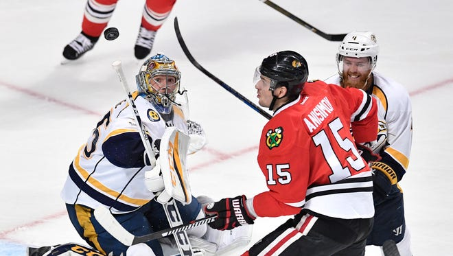 Nashville Predators goalie Pekka Rinne (35) defends against Chicago Blackhawks center Artem Anisimov (15) in the third period of game one in the first-round NHL playoff series at the United Center, Thursday, April 13, 2017, in Chicago, Ill.