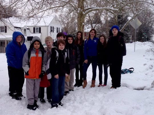 """P.S. DuPont school children await the  bus Tuesday morning for their 2-hour delay on Brandywine Boulevard at Rodman Road this morning. """"I'm ready for summer!"""" Eighth grader Gillian Palmer said."""