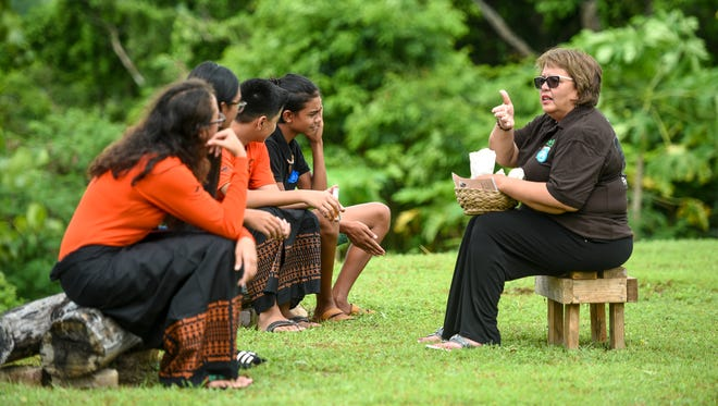 Zita Pangelinan, right, Håya Foundation president, offers a quick demonstration of traditional Chamoru healing, using local herbs and plants, to Pineksai Håya participants while at the Sagan Kotturan Chamoru Cultural Center in Tamuning on Friday, Aug. 3, 2018.