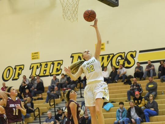 Tri-Valley's Audrey Spiker goes up for a layup against John Glenn on Monday. The Scotties won 51-30.