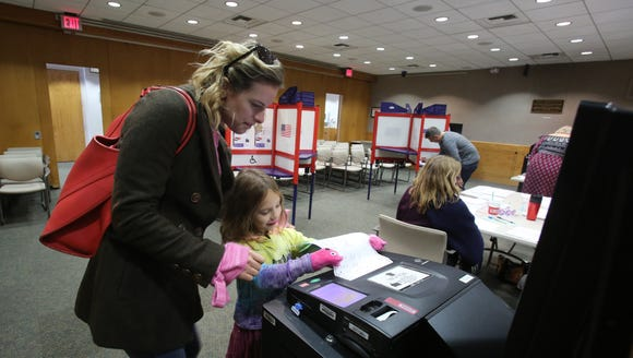Samantha Block of Chappaqua casts her vote with daughter