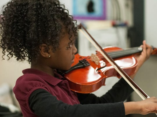 Kelsy Jackson of Belfair Montessori Magnet plays the viola during Kids' Orchestra lesson at Belfair Montessori Magnet.