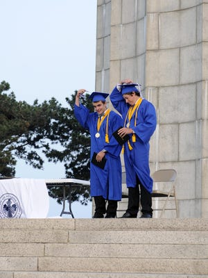 Elliot William Kowalski and Gunnar Hildebrandt Auger move their tassels to the other side after graduating from Put-In-Bay High School.