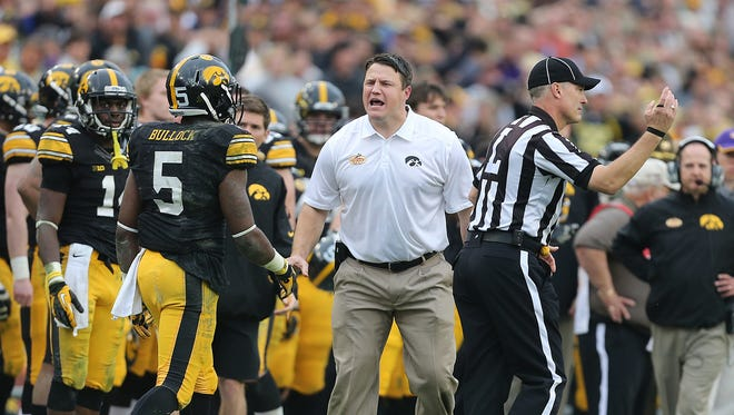 Iowa offensive line coach Brian Ferentz tries to generate a pass interference call after receiver Damon Bullock was hit by LSU's Craig Loston on Wednesday, Jan. 1, 2014, in Tampa, Florida.