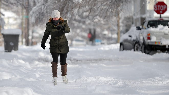 Amanda Reynolds took advantage of the snow to try out a friends cross country skis near 20th and New Jersey Streets in Indianapolis as a major snowstorm and negative temperatures shut down the city and surrounding counties on Monday, January 6, 2014.