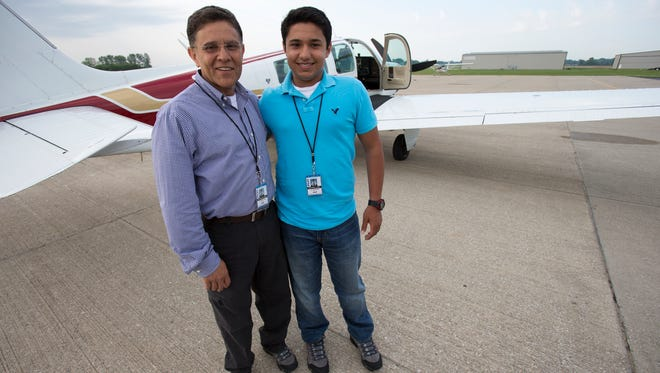 Babar Suleman and his son Haris Suleman, 17, Plainfield, are heading out on an around-the-world flight that they're hoping will take 30 days, Greenwood, Thursday, June 19, 2014.