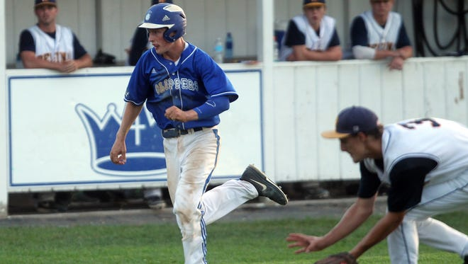 Clear Creek Amana's Jake Neubauer races to home plate during the Clippers' game at Regina on Tuesday, June 24, 2014. David Scrivner / Iowa City Press-Citizen