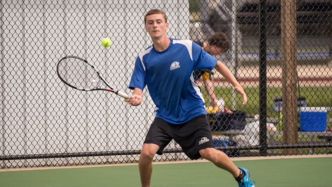 Harper Creek No. 1 singles player Tanner Wilcox during All City Tennis held at Harper Creek courts on Thursday.