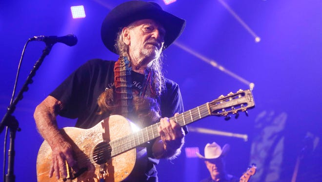 This March 15, 2014, file photo shows Willie Nelson performing at the iTunes Festival during the SXSW Music Festival in Austin, Texas. The country music icon who already had a downtown street and 8-foot statue in his honor in Austin, and added a spot in the inaugural class of the Austin City Limits Hall of Fame on Saturday, April 26, 2014.